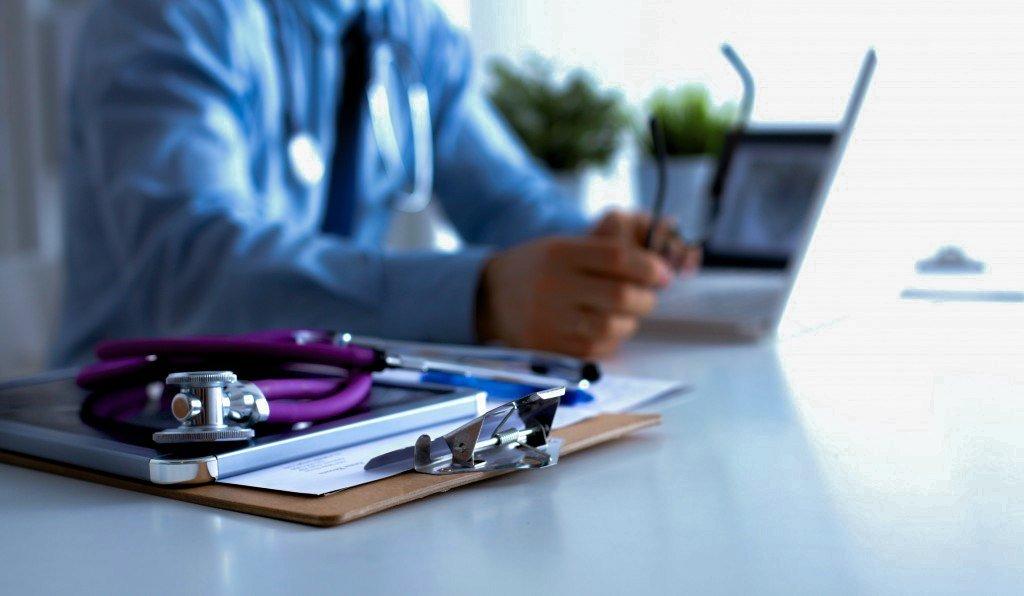 Physician Meeting Malpractice Insurance